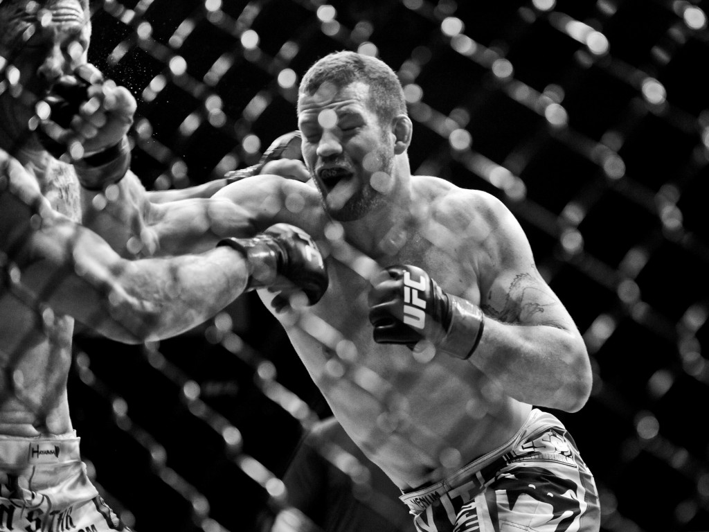 Nate Marquardt lands a punch against Dan Miller during the Ultimate Fighting Championship UFC 128 at the Prudential Center.