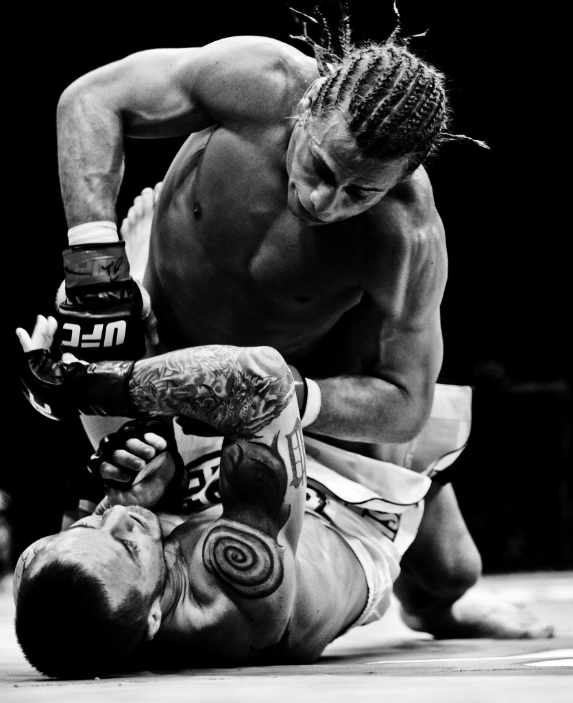 Urijah Faber on top of Eddie Wineland during the Ultimate Fighting Championship UFC 128 at the Prudential Center.