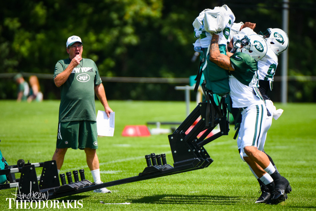 New York Jets fullback Tommy Bohanon (40) hist the sled during training camp at the practice facility in Florham Park on Saturday August 1st, 2015. by Andrew Theodorakis